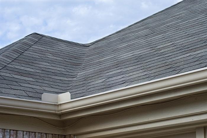 Rain Gutters Splash Guard on Roof against blue sky
